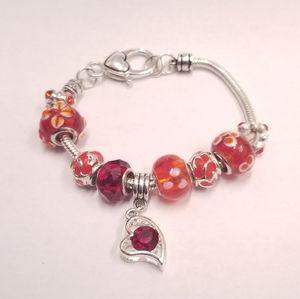 Heart themed charm silver bracelet
